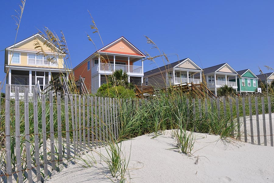 The distinctive color beach homes of Surfside Beach .