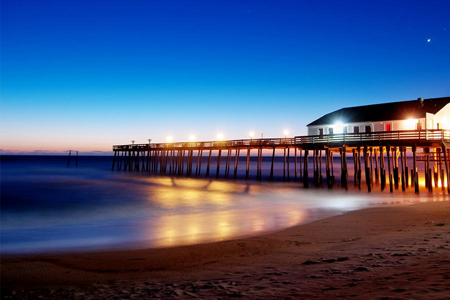 A tranquil shot of the Kitty Hawk pier at dusk.