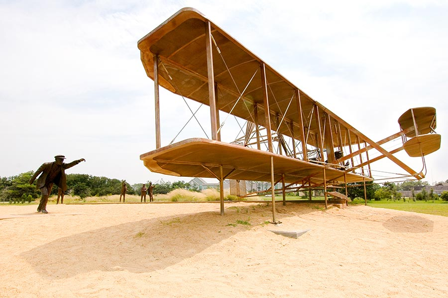 The Wright Brothers Memorial celebrates the first successful flight by a powered machine. a replica of the Wright Brothers airplane is seen here.