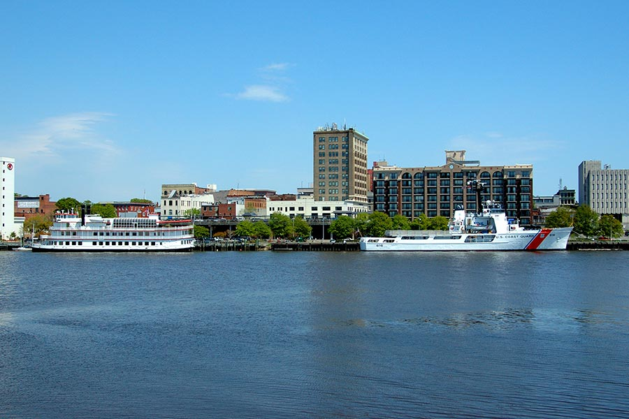 The Riverboat and Coast Guard cutter are docked on the Cape Fear River in Downtown Wilmington.
