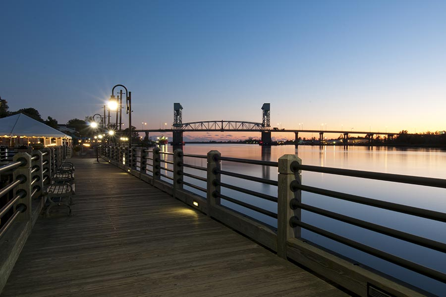 The Wilmington Riverwalk offers beautiful views in the evenings.